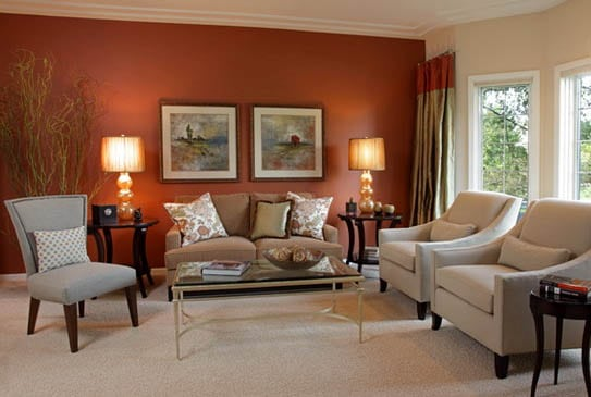 Subdued red living room paint ideas and furniture arrangement