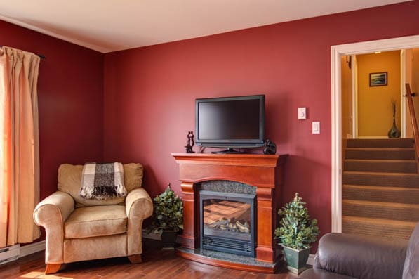 Red living room paint ideas with furniture and warm tones
