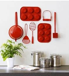 Utensils hung on wall as kitchen decor ideas in white kitchen