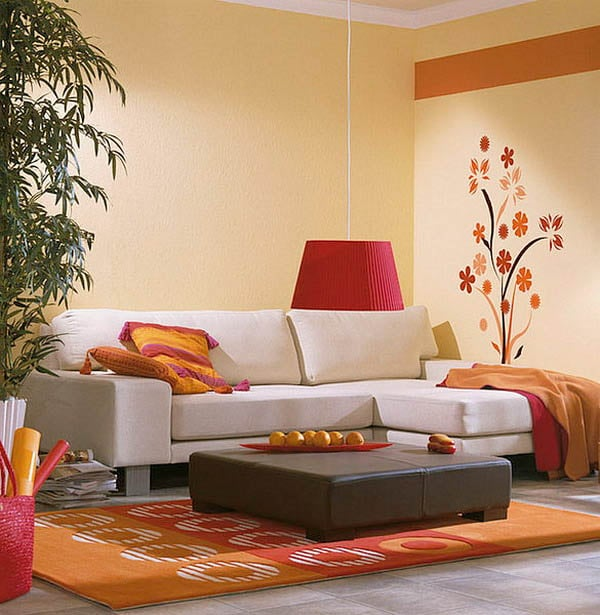Small orange room floral decal on living room wall