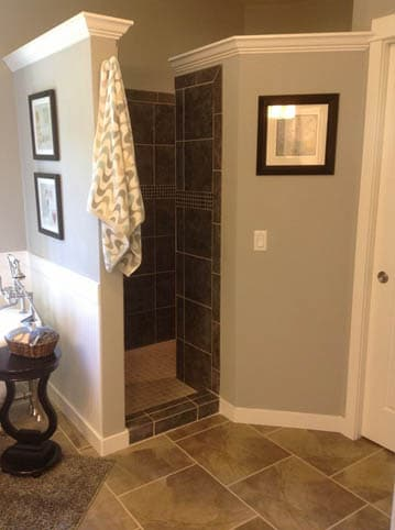 Stone walled shower areas in bathroom