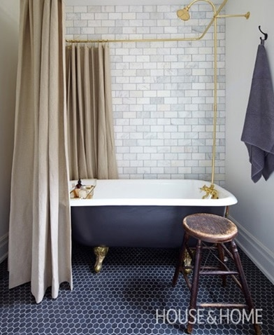 Vintage claw foot tub and shower in gray bathroom