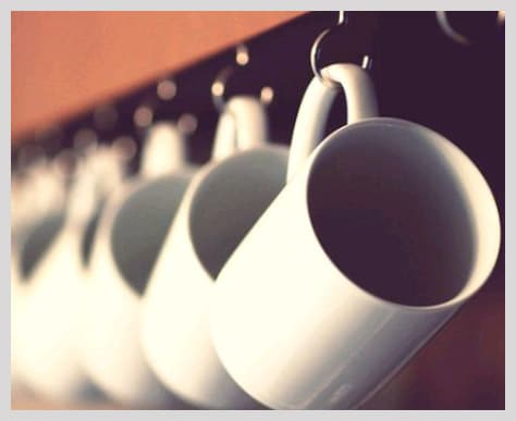 Hang your cups on hooks to optimize your kitchen space