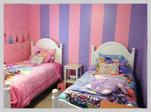 Pink and purple kids room with beds