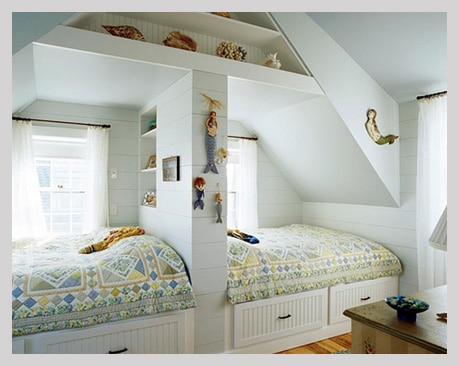 Attic sleeping area in white with wall storage