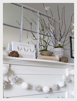 Old mirror used on mantel in white living room