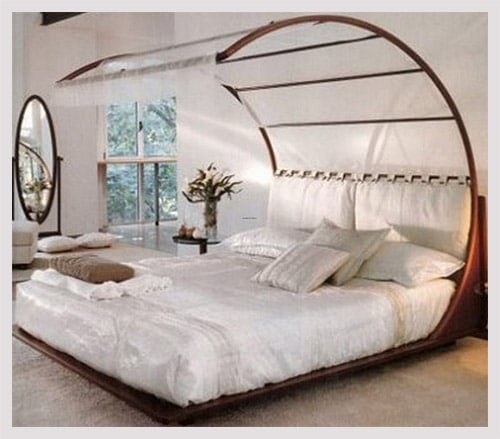 Canopy bed in white romantic bedroom