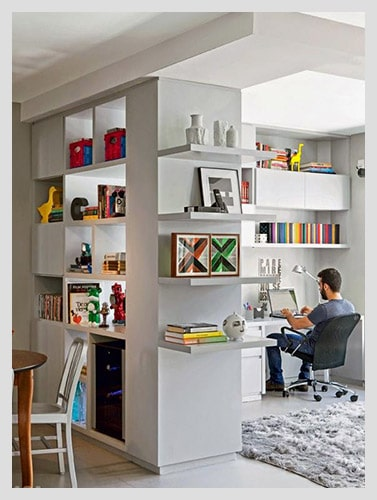 Divided home office with storage space and shelves