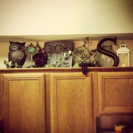 Knick knacks in extra space above cabinets
