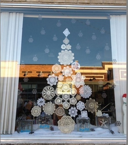 Christmas doilies in shape of tree in windo