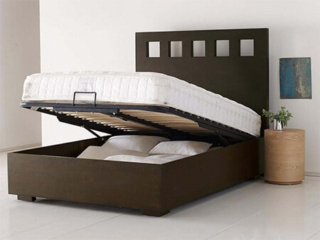 Brown bed with extra storage in bedroom
