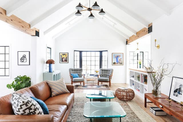 Battery Powered Light in bright living room with wood beams and brown couch