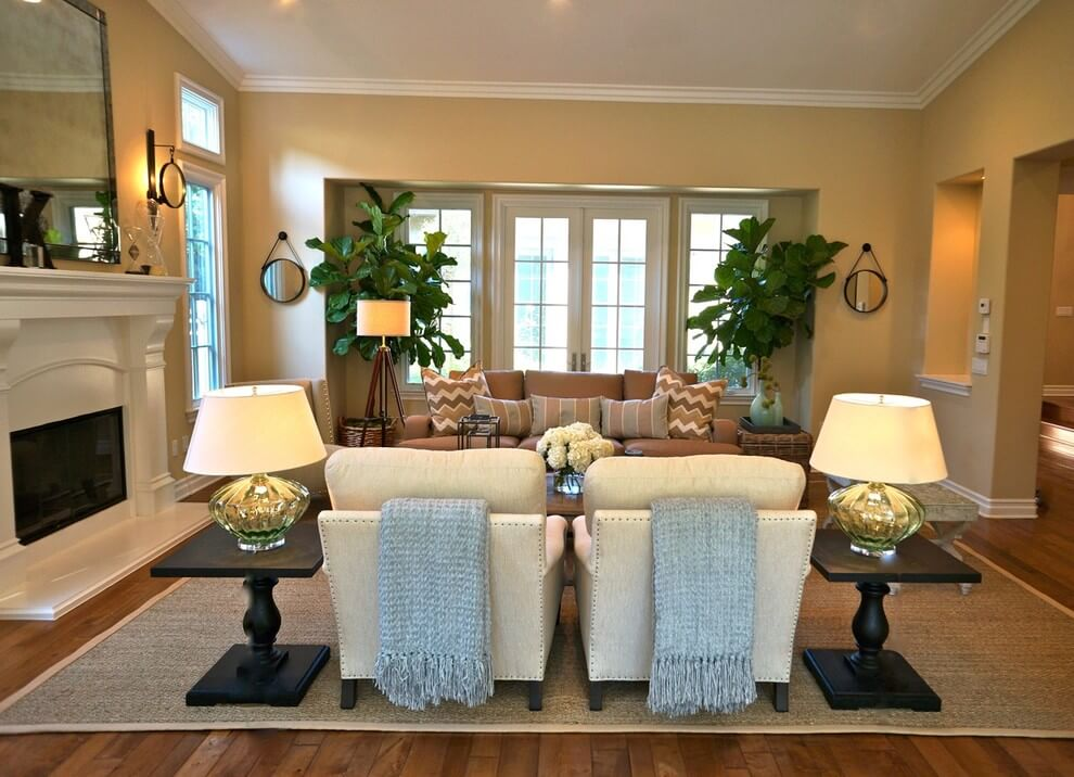 Table lamps in white living room on end tables with plants