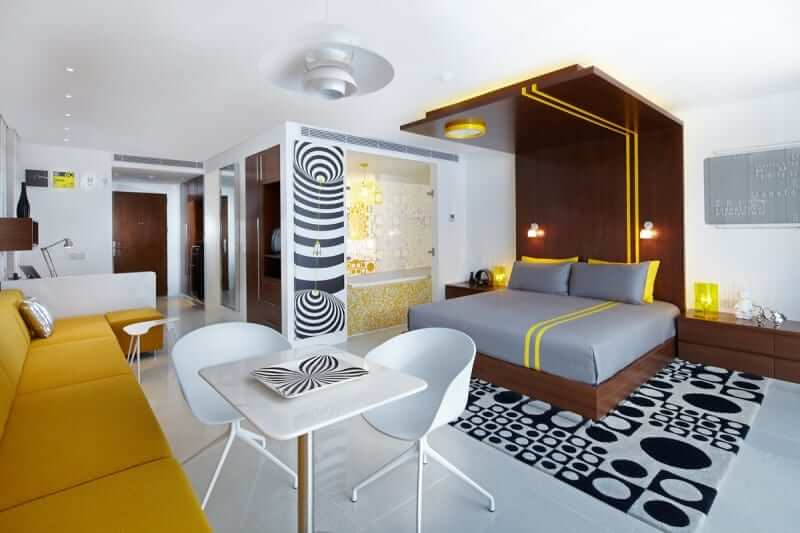 Floor To Ceiling Headboards in brown yellow and white bedroom