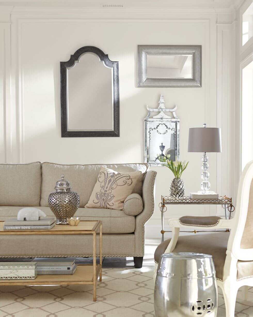 White living room with grey accents and framed mirrors