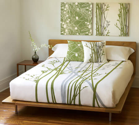 Earthy home decor ideas in white bedroom with artwork and plants