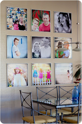 Photo collage on wall in dining room black and white and colored pictures