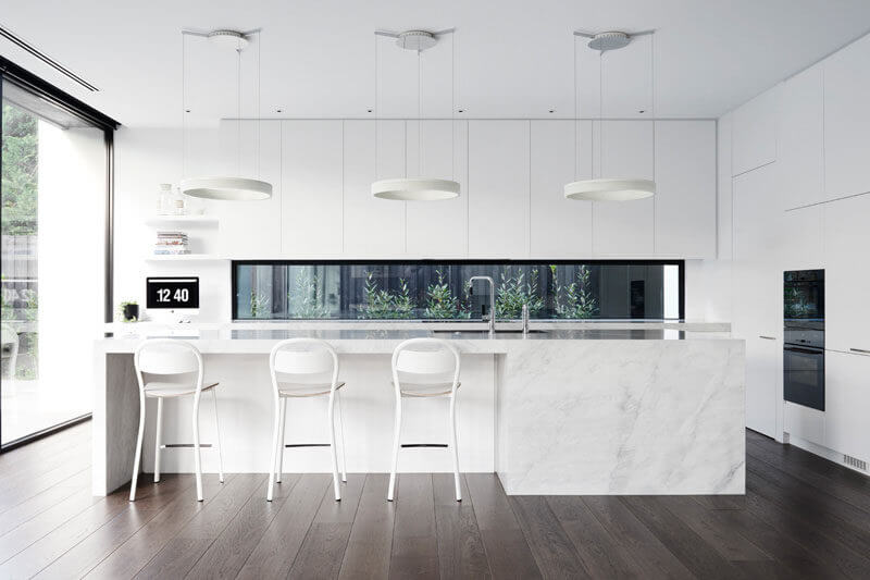 Kitchen window backsplash ideas in white with island and three chairs and wood flooring