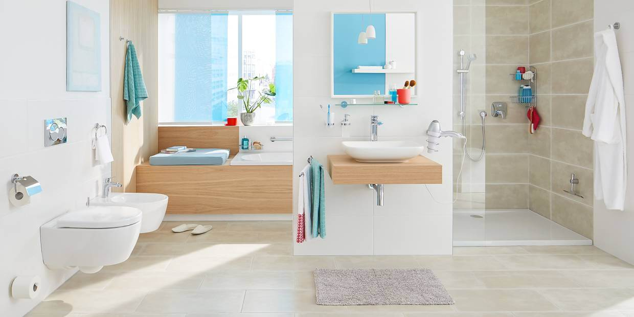 White bathroom with cool accessories vanity and shower with wood accents