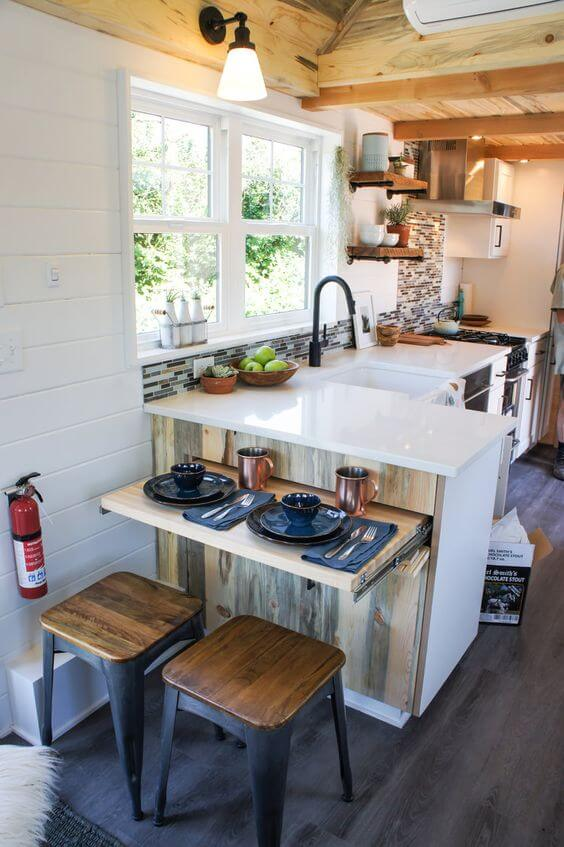 Small slide out breakfast bar with wooden topped stools