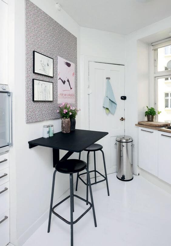 A floating breakfast bar attached to the kitchen side wall
