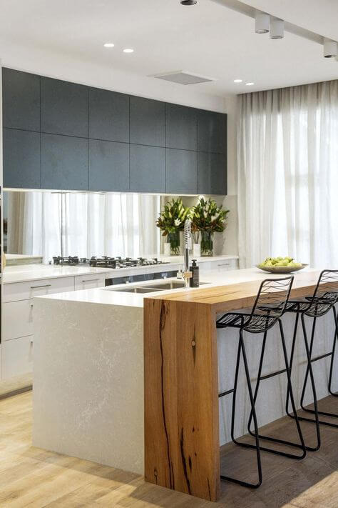 Center Island with Breakfast Bar made of wood with black chairs