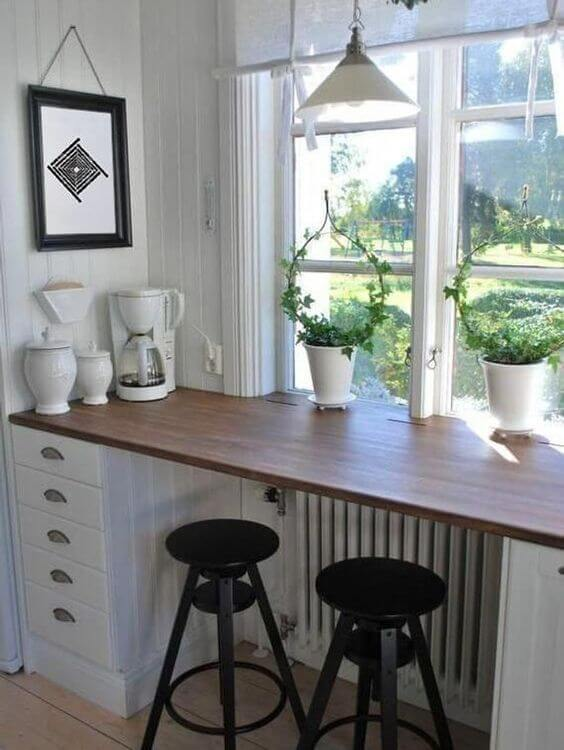 Wooden windowsill breakfast bar with wood top and plants