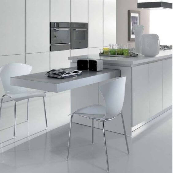 Slide out breakfast bar with white kitchen and island