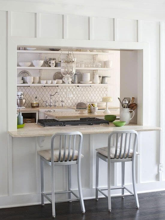 Wall cut out bar in with kitchen with shelving