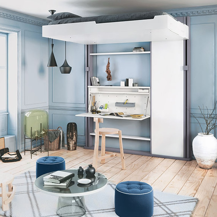 Electric bed lift with desk in blue room with tiny decor