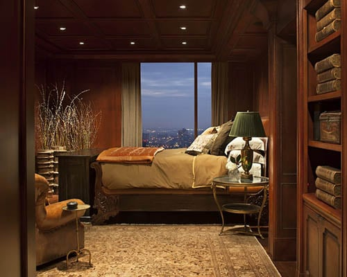 Masculine Bedroom in brown with bookshelves and decor
