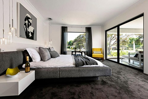 Masculine Bedroom in grey with dark rug and large windows Bachelor Pad Ideas