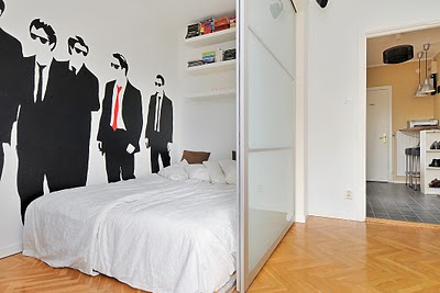 built in room divider in white room with wall mural