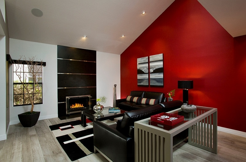 dark warm masculine color with red wall black furniture and fireplace