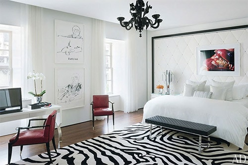 stylish rug to the floor white bedroom with red chairs and chandelier Bachelor Pad Ideas