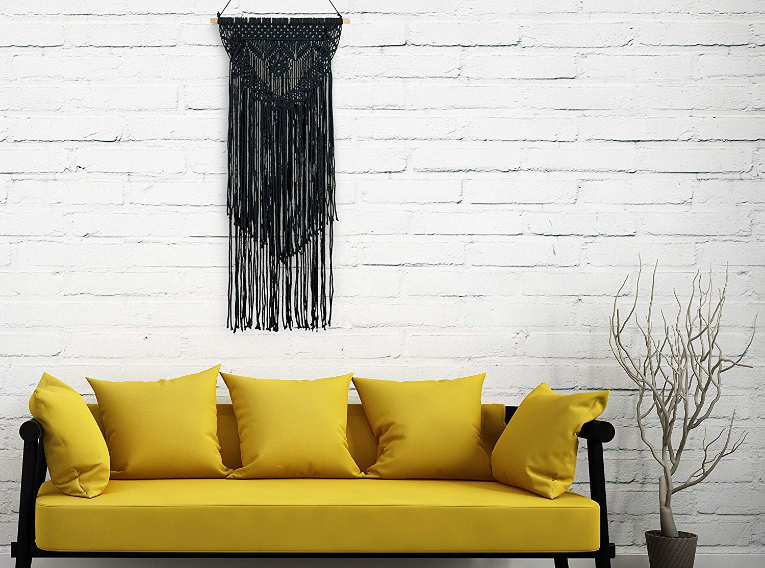 Boho Macrame Hanging Woven Decor with yellow couch and white brick wall