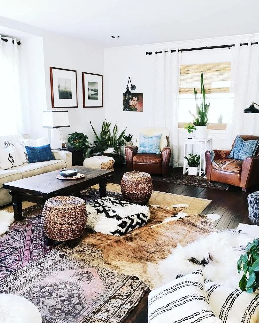 Boho farmhouse living room decor with white couch chairs and other bohemian decorating ideas