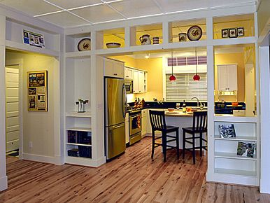 Built in cabinets in white with yellow kitchen walls