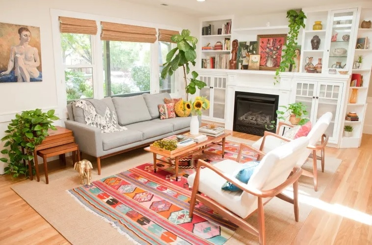 Cherry patterned bohemian style living room with wall art fireplace and shelves in white room