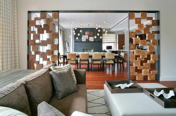 Split living room ideas with Geometrically shaped Wood cubby separators