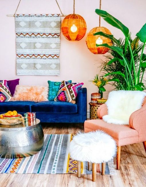 Boho lamps next to blue couch with boho pillows and other bohemian decorating ideas