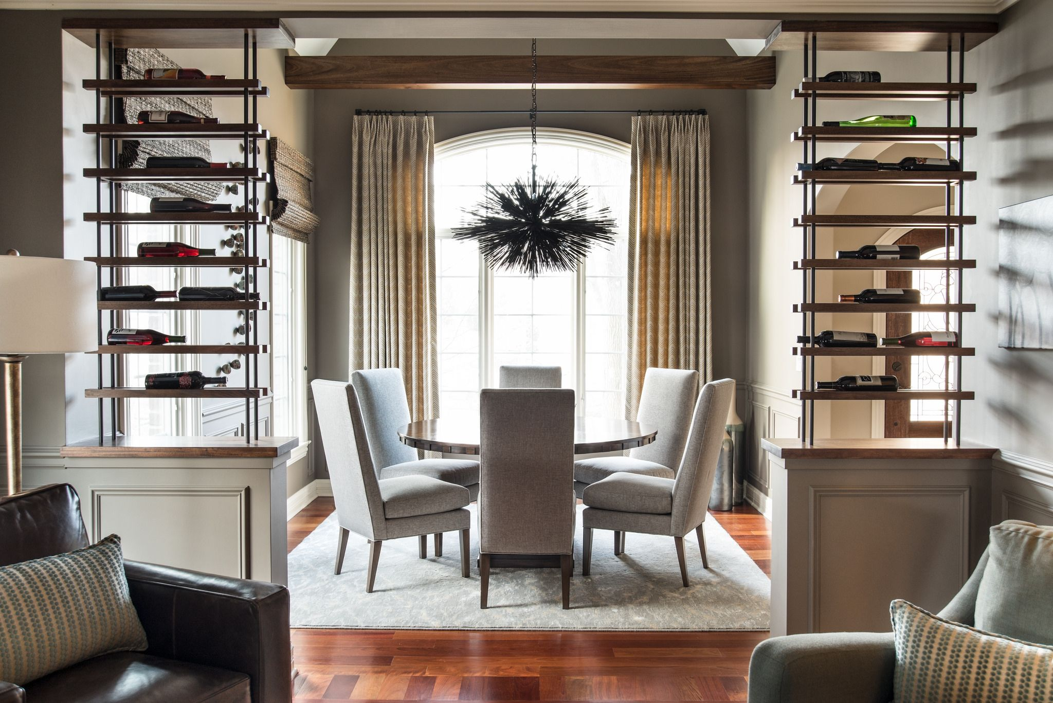 Wine Racks as a divider in dining room on area rug