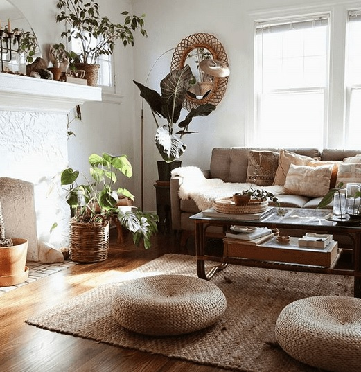 Boho decor with floor cushions on wooden floor in white room