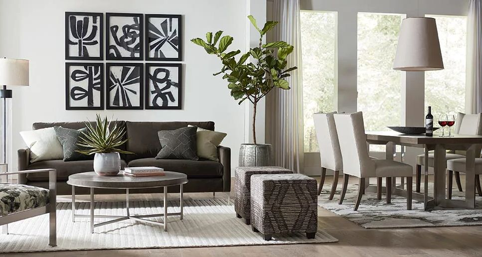 furniture to create different spaces with area rugs in white room