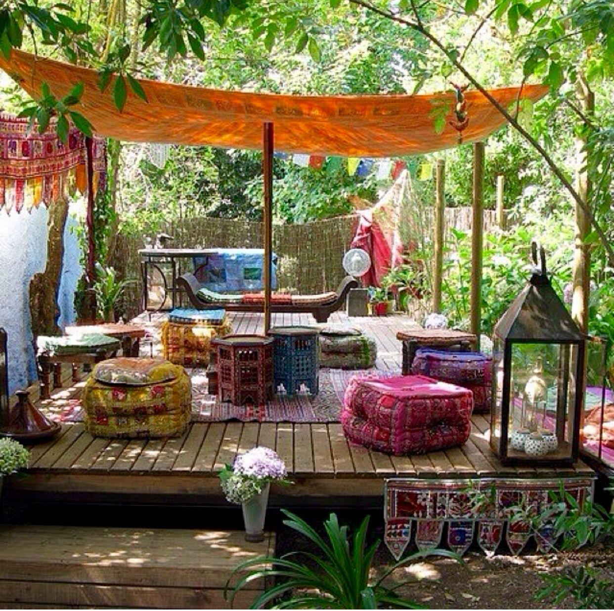 Bohemian outdoor sitting area with chairs and carpet
