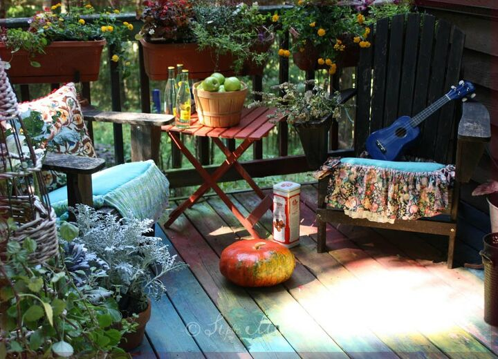 Bohemian deck with chairs plants and apples in a tub