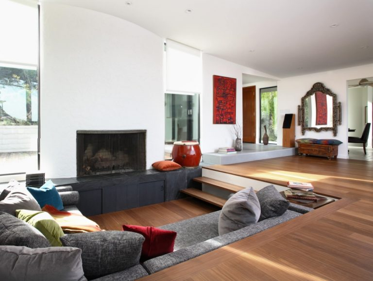 space to divide open living space with sunken space with grey couch