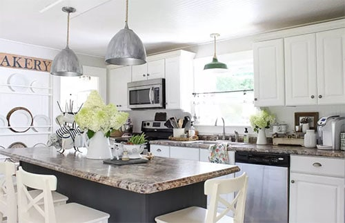 Bead Board Ceiling with white cabinets and island with plant