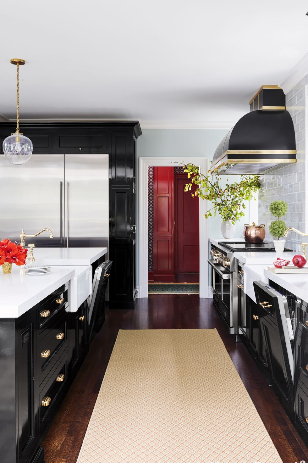 Black kitchen with gold accents and metal appliances