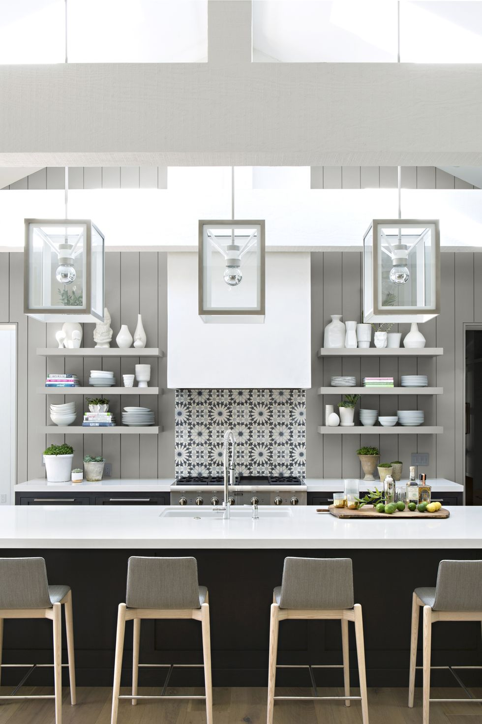 Blizzard Caesarstone countertop in gray kitchen with storage shelves and square lighting
